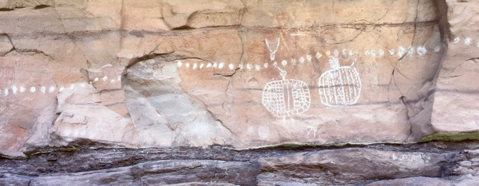 Petroglyphs.  No one really knows what they mean.
