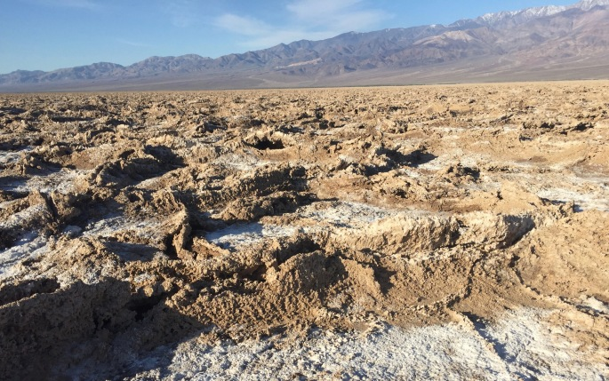 The terrain becomes rough as salt and dried mud mix.
