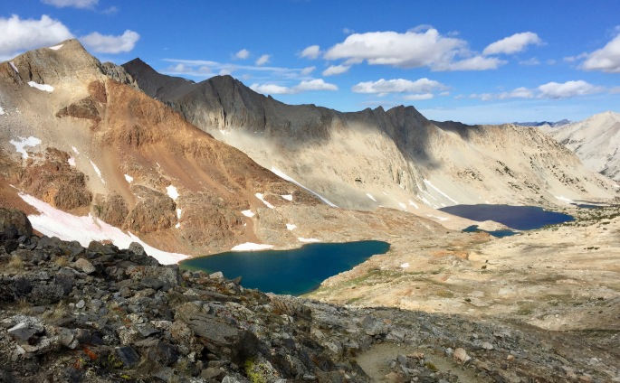 The view to the south from Pinchot Pass.  Two basic mouintain colors.  Two lakes at slightly different elevations and colors.  One awestruck hiker.