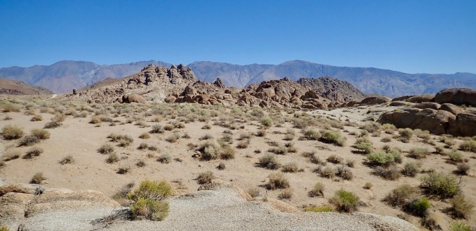 The backdrop for this rock scene is the Inyo mountains.
