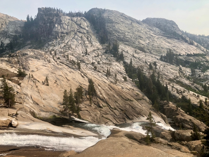 The Tuolumne River cascades down the canyon, which is not yet very deep.