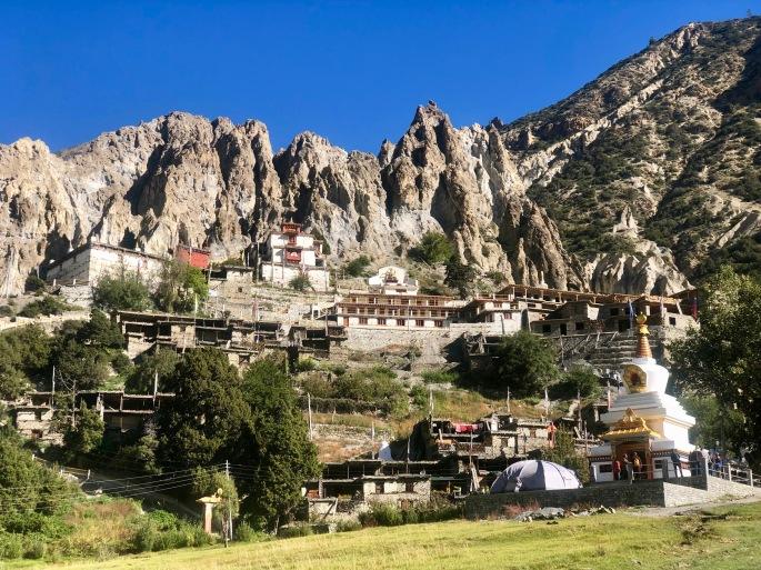 Bottom right: Stupa.  Center: Gompa (monastery).  Top: Badlands.