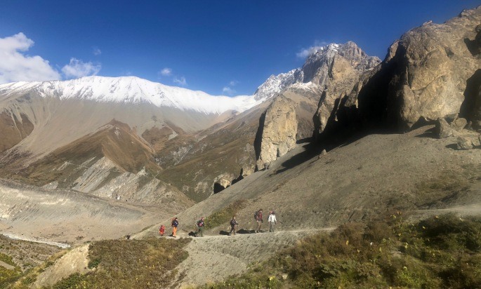 Trekkers enjoy the sublime mountain scenery on a clear mountain morning